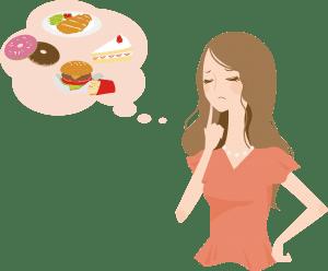 食べ物の誘惑にかられるダイエット中の女性